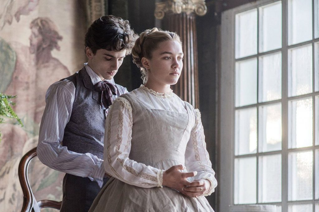 A scene from Little Women in which a man I don't know is doing up a similarly unknown to me's bodice. It might not be a bodice but you get the idea